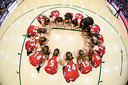 CVU huddles together during the Vermont high school girls division I basketball championship between the St. Johnsbury Hilltoppers and the Champlain Valley Union Redhawks at Patrick Gym on Sunday afternoon March 11, 2018 in Burlington. (BRIAN JENKINS/for the FREE PRESS)