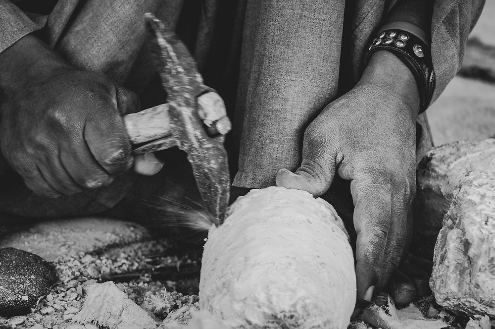 An Egyptian man works at an alabaster factory, creating an alabaster jar in Luxor, Egypt. (April 12, 2010)