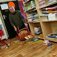 Tom Glynn starts the clean up after prefabs in Ennis National School were broken into last week.<br /> Photograph by Yvonne Vaughan