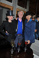 Left to right, URSULA FLANNERY, PHILIP TREACY and JEFFERSON HACK at a dinner hosted by Pablo Ganguli and Ella Krasner to celebrate the 10th Anniversary of Liberatum and in honour of Sir Peter Blake held at The Corinthia Hotel, Nortumberland Avenue, London on 23rd November 2011.