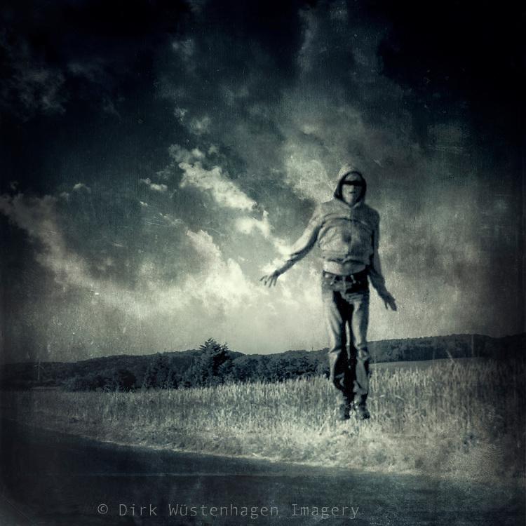 Man captured jumping beside a field