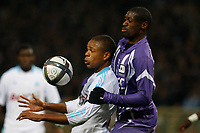 FOOTBALL - FRENCH CHAMPIONSHIP 2010/2011 - L1 - TOULOUSE FC v OLYMPIQUE MARSEILLE - 20/11/2010 - PHOTO PHILIPPE LAURENSON / DPPI - MOHAMED FOFANA (TFC) / LOIC REMY (OM)