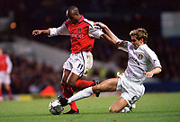 Sylvian Wiltord (Arsenal) Jon Woodgate (Leeds United). Leeds United v Arsenal, F.A.Carling Premiership, 26/11/2000. Credit Colorsport / Stuart MacFarlane