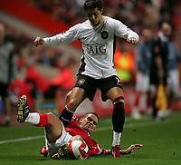 Photo: Lee Earle.<br /> Charlton Athletic v Manchester United. The Barclays Premiership. 23/08/2006. United's Cristiano Ronaldo (R) battles with Luke Young.