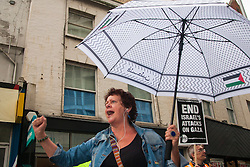 """London, July 5th 2014. Despite occasional drizzle, hundreds protest near the Israeli embassy in London against the ongoing occupation of Palestine and the west's support of """"Israel's collective punishment of Palestinians""""."""