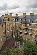 Somers Town on 26th June 2016 in London, United Kingdom. Somers Town, a district in north west London, is a large housing estate nestled between Euston, St Pancras and Kings Cross Library. Predominantly filled with social housing for the past 200 years, much of the area's housing was built in the twentieth century by the local authority.