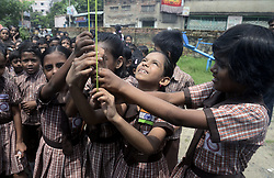 August 15, 2017 - Kolkata, West Bengal, India - Girl student host the India tri color flag on the occasion of Independence Day celebration on August 15, 2017 in Kolkata. School student celebrates India Independence Day by hosting flag in their school premises on August 15, 2017 in Kolkata. (Credit Image: © Saikat Paul/Pacific Press via ZUMA Wire)