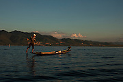 Firsherman on his chores in Inle Lake, Shane State, Myanmar.<br /> It is the second largest lake in Myanmar, is a freshwater lake located in the Nyaungshwe Town.<br /> Note: These images are not distributed or sold in Portugal