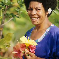 Fiji Islands, Viti Levu, Jean-Michel Cousteau, Fiji Islands Resort, resort staff picking hibiscus blossoms
