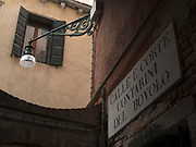Scala Contarini del Bovolo street sign with street lamp, Venice, Italy