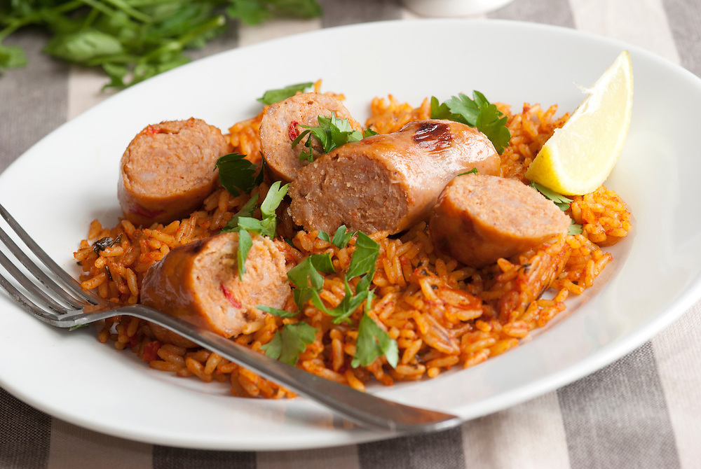 Pork sausages with tomato rice on a plate
