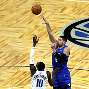 ORLANDO, FL - MARCH 01: Nikola Vucevic #9 of the Orlando Magic shoots over Dorian Finney-Smith #10 of the Dallas Mavericks during the first half at Amway Center on March 1, 2021 in Orlando, Florida. NOTE TO USER: User expressly acknowledges and agrees that, by downloading and or using this photograph, User is consenting to the terms and conditions of the Getty Images License Agreement. (Photo by Alex Menendez/Getty Images)*** Local Caption *** Nikola Vucevic; Dorian Finney-Smith