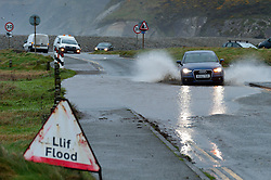 © Licensed to London News Pictures. 02/02/2017. Newgale, Pembrokeshire, Wales, UK. Vehicles negotiate a road with surface flooding at Newgale Beach in Pembrokeshire, Wales, UK. Strong winds and rain hit Pembrokeshire coastline in Wales, UK. Photo credit: Graham M. Lawrence/LNP