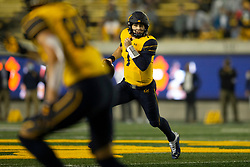 California quarterback Chase Garbers (7) scrambles out of the pocket during the first quarter of an NCAA college football game against Nevada, Saturday, Sept. 4, 2021, in Berkeley, Calif. (AP Photo/D. Ross Cameron)