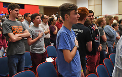 April 18, 2018 - Plantation, FL, USA - Marjory Stoneman Douglas student Adam Alhanti stands during the pledge to the flag before the start of the discussion of school safety between the public and the Broward County School Board in Plantation, Fla., on Wednesday, April 18, 2018. (Credit Image: © Jim Rassol/TNS via ZUMA Wire)