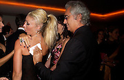Tamara Beckwith and Flavio Briavatore.  Andy & Patti Wong's Chinese New Year party to celebrate the year of the Rooster held at the Great Eastern Hotel, Liverpool Street, London.29th January 2005. The theme was a night of hedonism in 1920's Shanghai. . ONE TIME USE ONLY - DO NOT ARCHIVE  © Copyright Photograph by Dafydd Jones 66 Stockwell Park Rd. London SW9 0DA Tel 020 7733 0108 www.dafjones.com