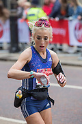 A female runner checking her time on Birdcage Walk during The Virgin London Marathon on 28th April 2019 in London in the United Kingdom. Now in it's 39th year, the London Marathon is a large sporting event with over 40,000 runners expected to take part.
