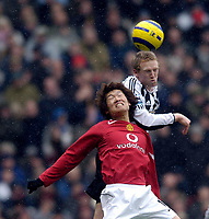 Photo: Jed Wee.<br /> Manchester United v Newcastle United. The Barclays Premiership. 12/03/2006.<br /> <br /> Newcastle's Peter Ramage (R) climbs above Manchester United's Park Ji Sung to win the ball.