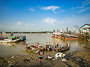 27 OCTOBER 2015 - YANGON, MYANMAR: Cross river ferries at a pier in the market at Aungmingalar Jetty in Yangon. The market is home to one of the largest fish markets in Yangon and a meat and produce market.    PHOTO BY JACK KURTZ