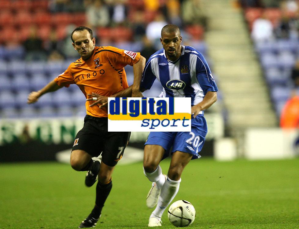 Photo: Sportsbeat Images.<br />Wigan Athletic v Hull City. Carling Cup. 28/08/2007.<br />Wigan's Caleb Folan (R) holds off Stuart Elliott