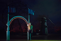 "© Licensed to London News Pictures. 14/05/2014. London, England. Randall Bills as Ferrando. Dress rehearsal of the Wolfgang Amadeus Mozart opera ""Così fan tutte"" at the London Coliseum. A new ENO production of Mozart's dark comedy set in the world of a 1950's Coney Island funfair. With Kate Valentine as Fiordiligi, Christine Rice as Dorabella, Marcus Farnsworth as Guglielmo, Randall Bills as Ferrando, Mary Bevan as Despina and Roderick Williams as Don Alfonso. Directed by Phelim McDermott, Conductor: Ryan Wigglesworth. Co-produced by the English National Opera and the Metropolitan Opera, New York. In collaboration with Improbable. 12 performances from 16 May to 6 July 2014. Photo credit: Bettina Strenske/LNP"