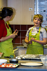 Pictured: Aileen Campbell met Malcolm Fitzharris (11) who is autistic and has issues eationg.  His father Sean brings him along to the class and Malcolm has developed his own suace for pizza which helps him understand that it is important to eat and be able to look after yourself.<br /> Public Health Minister Aileen Campbell joined a class at the Pilton Community Health Project which helps families gain confidence in the kitchen, ahead of the Scottish Government's consultation on its diet and obesity strategy being launched in the autumn<br /> Ger Harley | EEm 10 August  2017