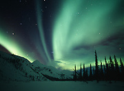 Aurora above the Endicott Mountains and Sixtymile Creek, early morning hours of March 5, 2003, Brooks Range, Alaska.