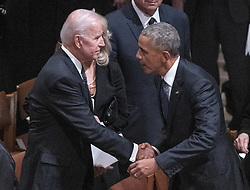 Former United States President Barack Obama, right, shakes hands with former United States Vice President Joe Biden, left, following the National funeral service in honor of the late former US President George H.W. Bush at the Washington National Cathedral in Washington, DC on Wednesday, December 5, 2018.<br /> Photo by Ron Sachs / CNP/ABACAPRESS.COM