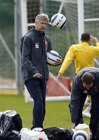 Photo: Chris Ratcliffe.<br /> Arsenal Training Session. UEFA Champions League. 18/04/2006.<br /> Arsene Wenger helps clear up the ball at the end of training