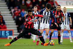 """AFC Bournemouth's Lys Mousset (left) and West Bromwich Albion's Claudio Yacob (right) battle for the ball during the Premier League match at the Vitality Stadium, Bournemouth. PRESS ASSOCIATION Photo. Picture date: Saturday March 17, 2018. See PA story SOCCER Bournemouth. Photo credit should read: Mark Kerton/PA Wire. RESTRICTIONS: EDITORIAL USE ONLY No use with unauthorised audio, video, data, fixture lists, club/league logos or """"live"""" services. Online in-match use limited to 75 images, no video emulation. No use in betting, games or single club/league/player publications."""