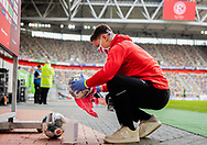 Ballboy cleans ball Ball junge , desinfiziert , einen Spielball , Sicherheitskonzept , Corona during the Fortuna Dusseldorf vs Paderborn Bundesliga match at Esprit Arena, Dusseldorf, Germany on 16 May 2020.