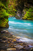 """The Quinault River is a 69-mile (111 km) long river located on the Olympic Peninsula in the U.S. state of Washington. It originates deep in the Olympic Mountains in the Olympic National Park. It flows southwest through the """"Enchanted Valley""""."""