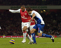 Photo: Olly Greenwood.<br />Arsenal v Blackburn Rovers. The Barclays Premiership. 23/12/2006. Arsenal's Julio Baptista and Blackburn's Lucas Neil