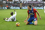 Martin Kelly of Crystal Palace and Modou Barrow of Swansea City during the Premier League match between Swansea City and Crystal Palace at the Liberty Stadium, Swansea, Wales on 26 November 2016. Photo by Andrew Lewis.