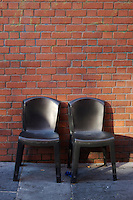 Two empty balck plastic chairs at the Temple Bar food market in Dublin Ireland