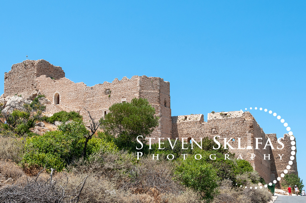 Rhodes. Greece. Kritinia Castle (Castle of Castello) situated on the west coast of Rhodes Island. Dating from 16th century the medieval strategic fortress was built by the Knights of St John and once boasted several coats of arms of several Grand Masters. It is surrounded by olive groves and pines wood and offers spectacular views of the Aegean Sea and the Wild West Coast of Rhodes Island.