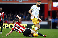 Atdhe Nuhiu of Sheffield Wednesday (R) is tackled by Chris Mepham of Brentford (L). EFL Skybet football league championship match, Brentford v Sheffield Wednesday at Griffin Park in London on Saturday 30th December 2017.<br /> pic by Steffan Bowen, Andrew Orchard sports photography.