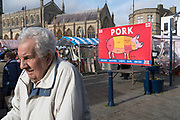 Boston Butt, advertisement for pork meat at Boston Market. Old white vote demographic for Brexit against immigrants<br /><br />Boston had the highest proportion of votes for Brexit in mainland UK. Boston in Lincolnshire was once a sleepy rural town. Since early the 21st century a large influx of economic migrants mainly from Eastern Europe have found work across Lincolnshire, working for the minimum wage in agricultural and construction industries, doing jobs that locals don't to do. Towns have expanded sometimes by 10% during this period. British business needs the migrant workers to survive, but but local people voted the highest proportion for Brexit, 75% against 'Remain', in a protest vote against migrant workers.