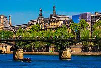 Looking toward Pont des Art (pedestrian bridge) with the Louvre Palace behind, along the River Seine, Paris, France.