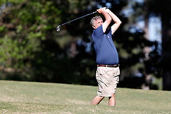 Paul Johnson tees off during the Chick-fil-A Peach Bowl Challenge at the Oconee Golf Course at Reynolds Plantation, Sunday, May 1, 2018, in Greensboro, Georgia. (Paul Abell via Abell Images for Chick-fil-A Peach Bowl Challenge)