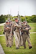 Confederate re-enactor march at Fort Moultrie Charleston, SC. The re-enactors are part of the 150th commemoration of the US Civil War.