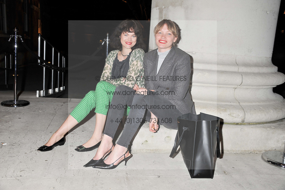 Left to right, JASMINE GUINNESS and SARA GILMOUR at a party hosted by Ines de la Frassange and Bruno Frisoni for Roger Vivier to launch the Roger Vivier book held at The Saatchi Gallery, London on 24th April 2013.
