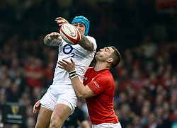Jack Nowell of England pats the high ball back<br /> <br /> Photographer Simon King/Replay Images<br /> <br /> Six Nations Round 3 - Wales v England - Saturday 23rd February 2019 - Principality Stadium - Cardiff<br /> <br /> World Copyright © Replay Images . All rights reserved. info@replayimages.co.uk - http://replayimages.co.uk