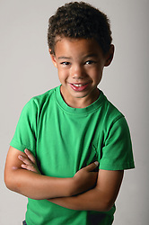 Portrait of a young boy with his arms folded,