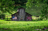 An old Barn near Burnsville, North Carolina with both an American and Rebel flag.
