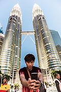 Tourist in the Petronas Towers, Kuala Lumpur, Malaysia. December / 2018.