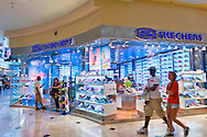 Garden City, New York, USA. 15th August 2013. Shoppers walk by Skechers footwear store, on the day of BACK AT IT, the Back to School event at Roosevelt Field shopping mall, which is one of the ten largest malls in the United States of America.