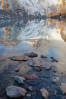 Reflections of sunrise lit mountains at Lagune de Los Tres, Los Glaciares National Park, Argentina. .