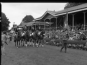 Aga Khan Trophy..1979..10.08.1979..08.10.1979..10th August 1979..The annual staging of the Aga Khan Cup took place  at the Royal Dublin Showgrounds, Ballsbridge,Dublin today.It was the first time since 1937 that Ireland won the trophy outright. The winning Irish team comprised of Paul Darragh,Capt Con Power,James Kernan and Eddie Macken..Picture shows the Ireland Team parading in front of the main stand at the Aga Khan Cup in the R.D.S.Dublin.