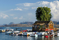 Sep 07, 2003; Lake Havasu, Arizona, USA; Summer watersports, boating, recreation on the Colorado River's Lake Havasu.  Summer heat attracts boaters, waterskiers, waverunners and party goers from all over the world to the Arizona desert. Nautical Inn newest attraction their Tiki bar on the water that opened to the public in August 2003 with drive up boat access to the beach and resort.